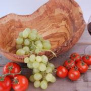 beautifully carved natural shape olive wood fruit bowl Dish , it is carved out of a single piece of olive wood . just take a look at the lovely grains of the wood which create an exceptional honey colour , it looks much better when you see it in reality. The measurements of this product are not exact because of its natural shape Dimensions: 30 - 35cm