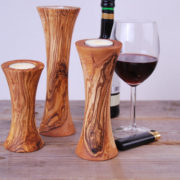 """Set of 3: Olive Wood Tealight Holders Ø ca. 6 - 7cm (2.7"""") height: 12 cm / 16 cm / 20cm (4.7"""" / 6.3"""" / 7.9"""") beautiful table decoration ***************************************************************************************************** Maintenance: Olive wood is a natural product that lives. By following the below instructions you will be able to enjoy for a lifetime this authentic olive wood product. - clean using a soft sponge, tepid water and soap. Dry with a kitchen cloth - from time to time after cleaning coat with salad oil to prevent the wood from getting dry - do not put this product in the dishwasher, leave it soaking in water or expose it for long to a source of heat"""